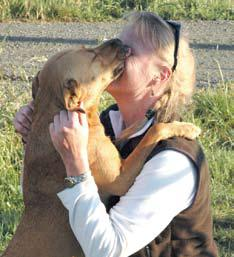 Photo of dog licking person