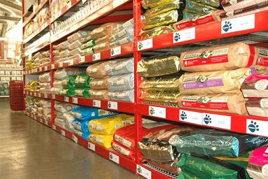 Photo of racks of bags of dog food